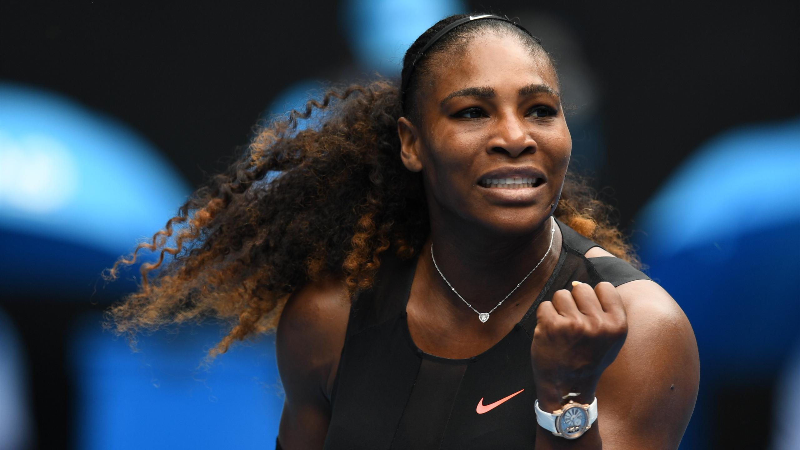 Serena Williams of the US reacts after a point against Switzerland's Belinda Bencic during their women's singles match on day two of the Australian Open