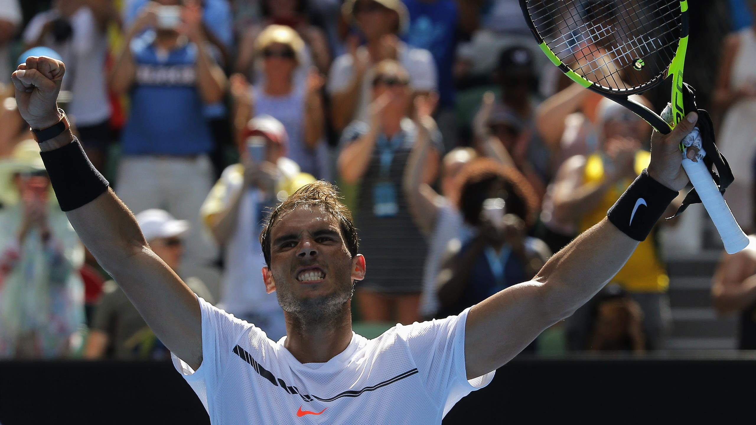 Spain's Rafael Nadal celebrates after winning his Men's singles first round match against Germany's Florian Mayer
