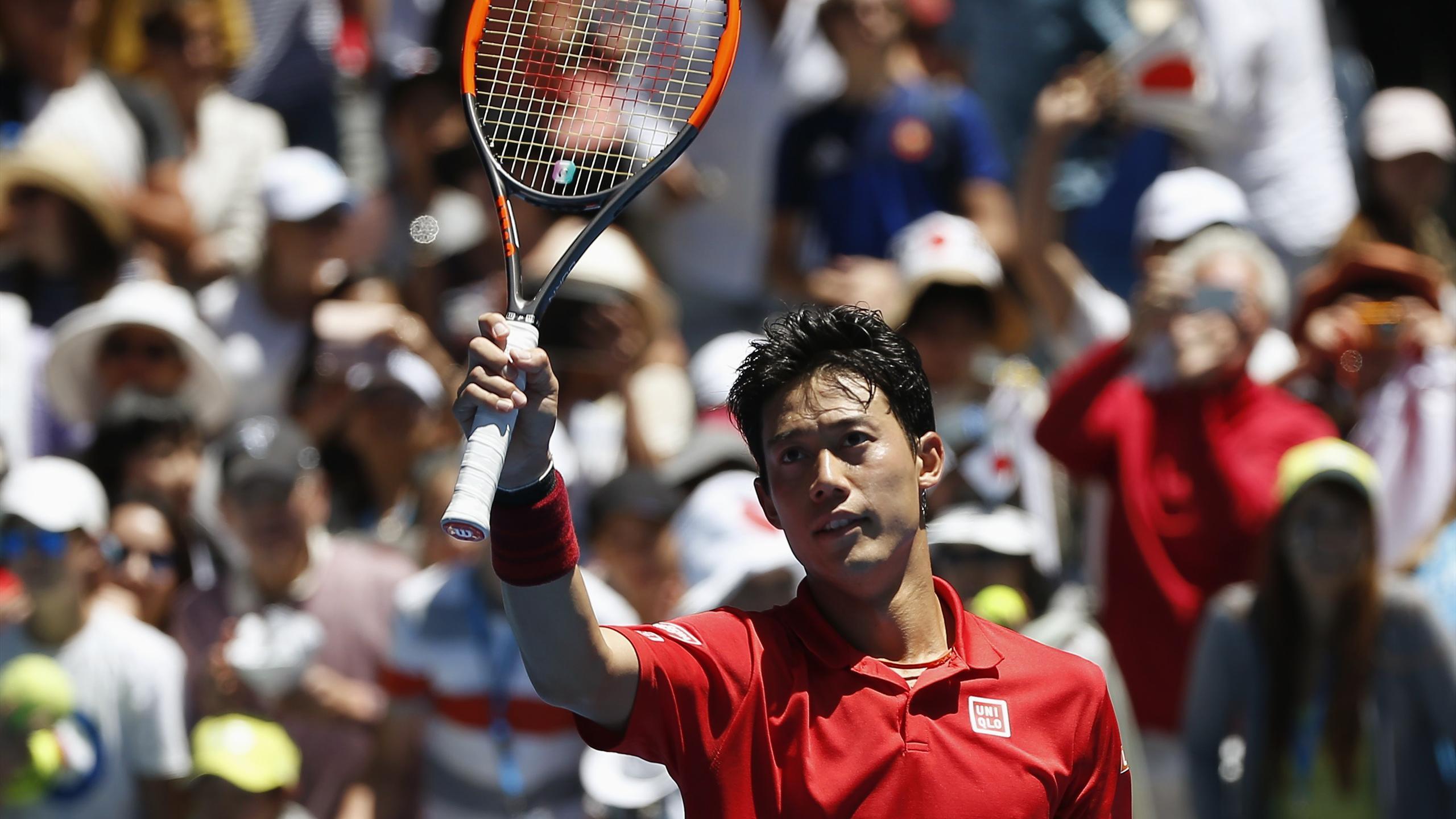 Japan's Kei Nishikori celebrates after winning his Men's singles second round match against France's Jeremy Chardy