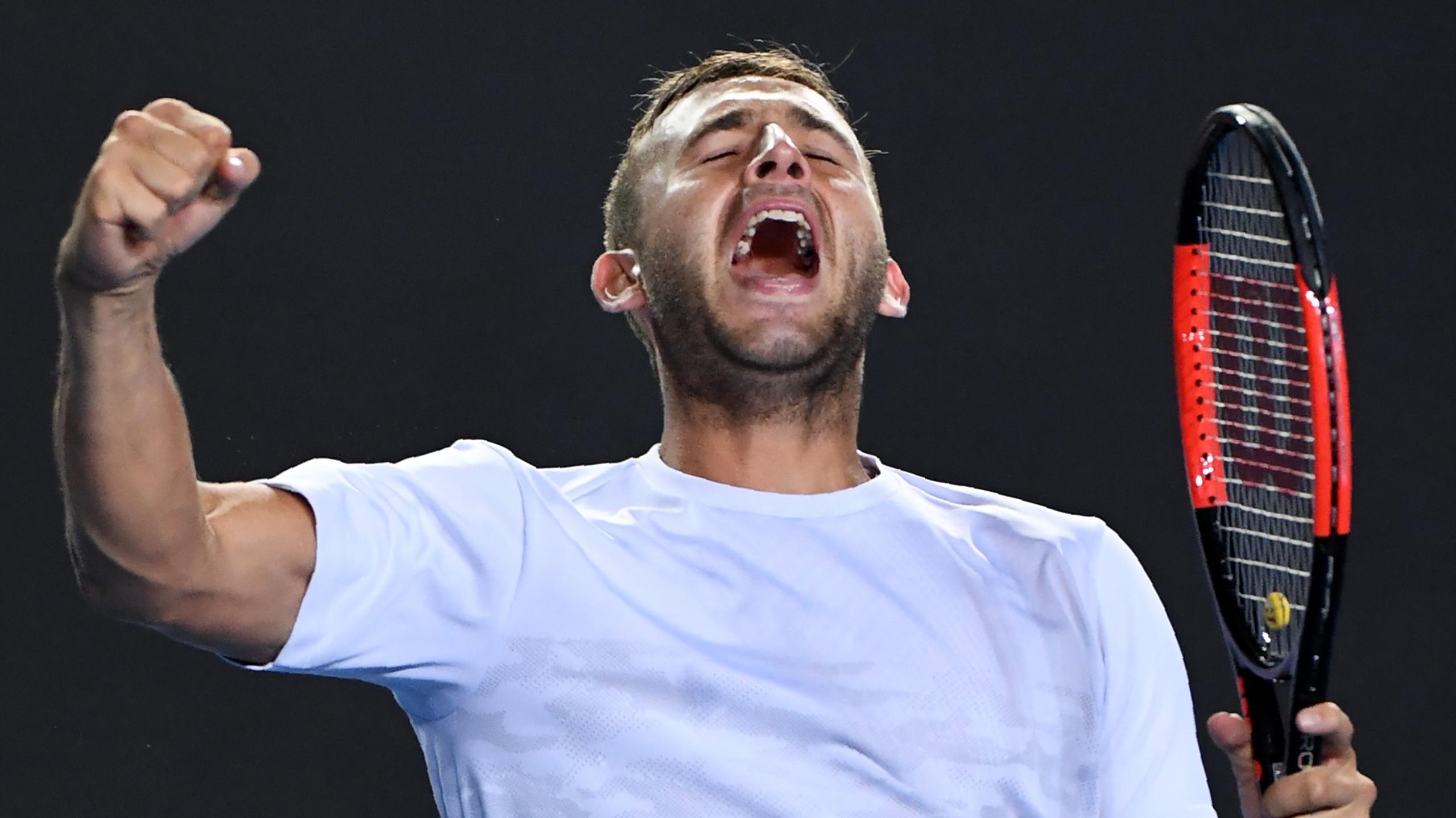 Britain's Daniel Evans celebrates his victory against Croatia's Marin Cilic
