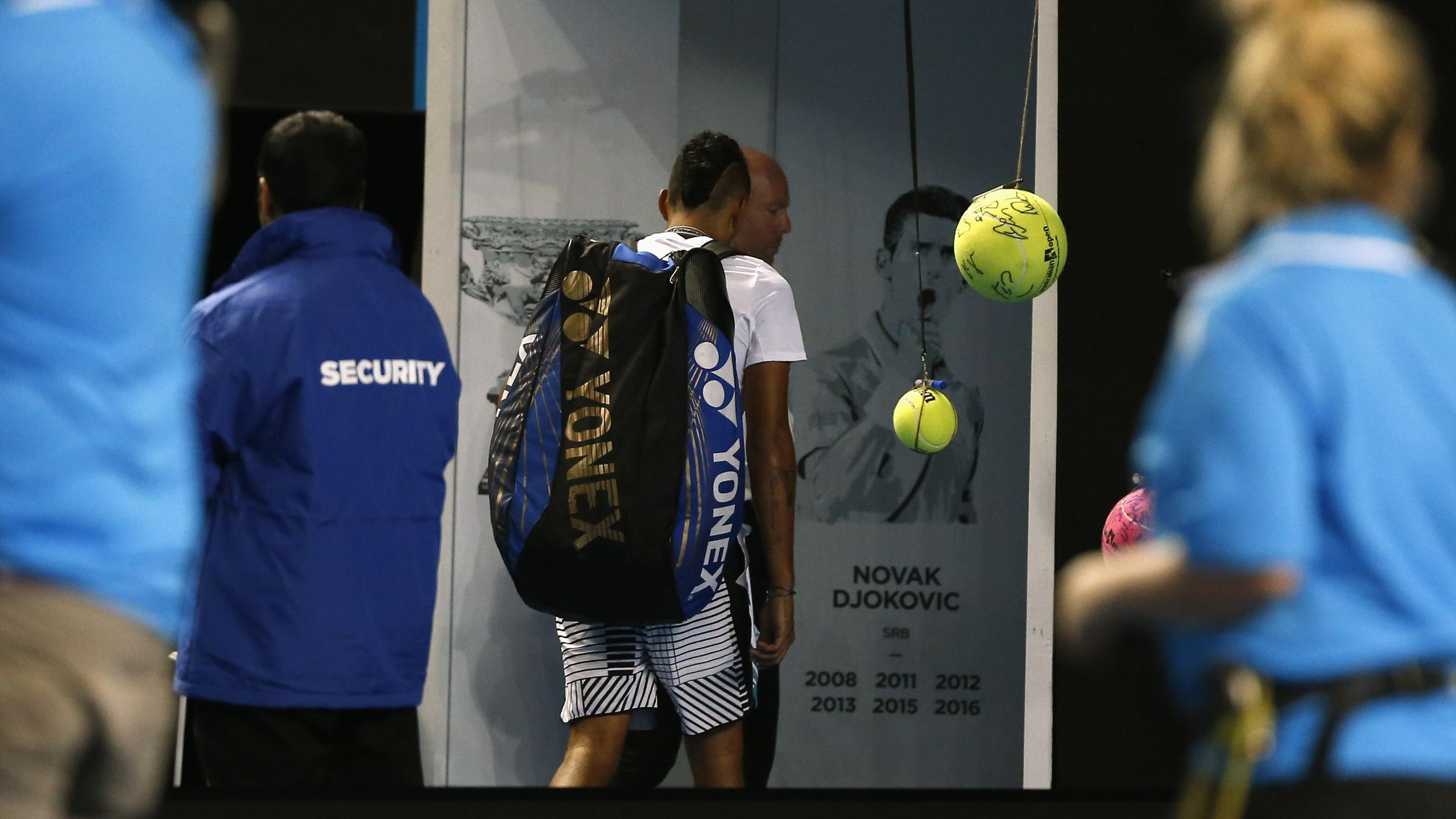 Australia's Nick Kyrgios walks off the court after losing his Men's singles second round match against Italy's Andreas Seppi