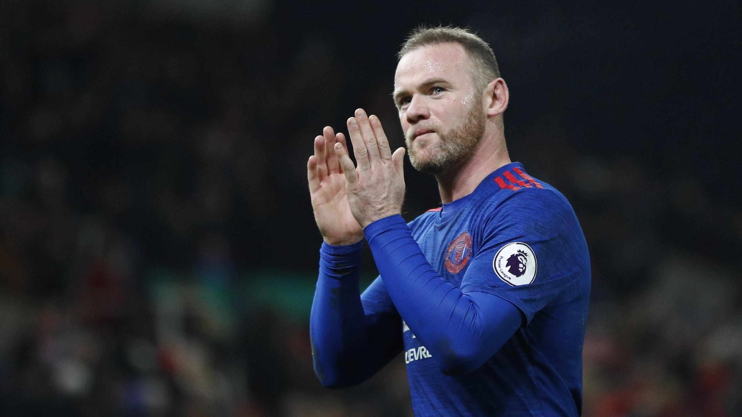 Manchester United's Wayne Rooney applauds fans