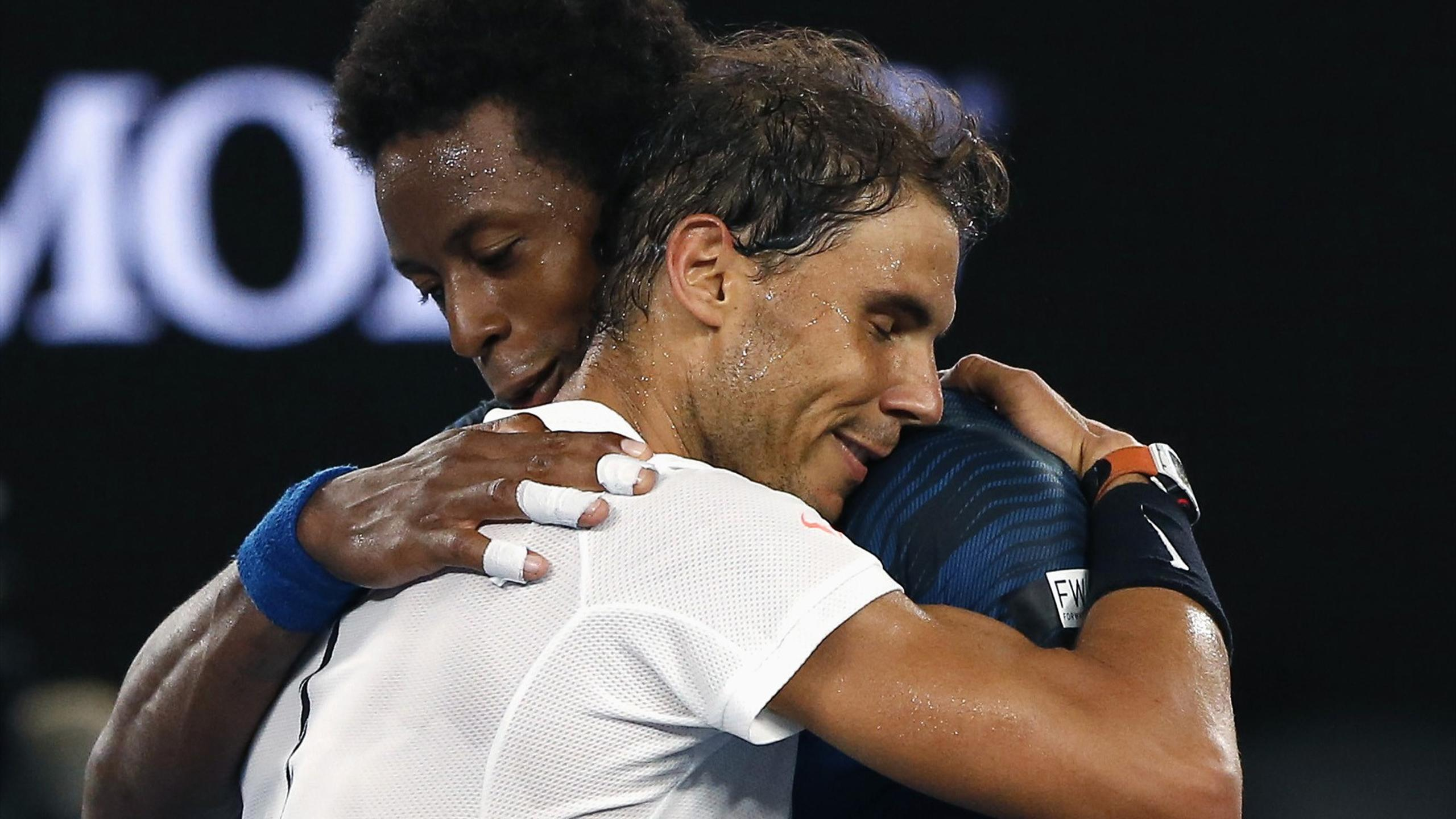 Spain's Rafael Nadal consoles France's Gael Monfils after winning their Men's singles fourth round match