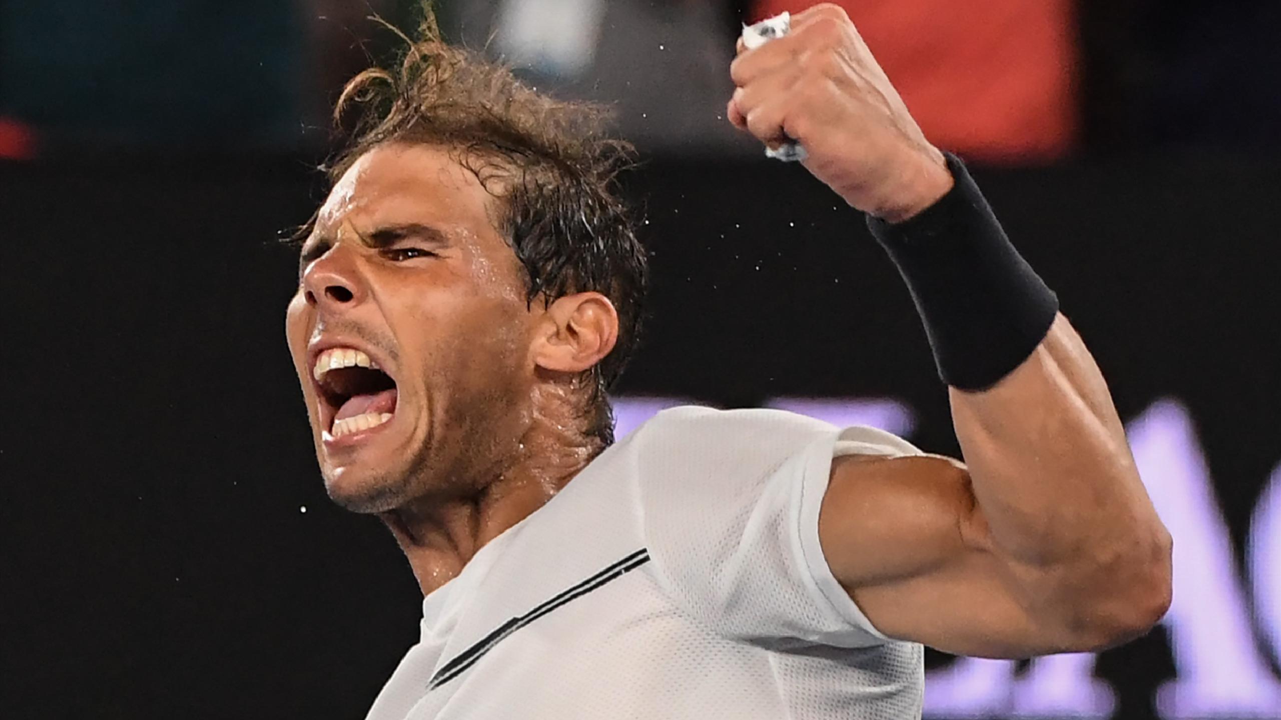 Rafael Nadal celebrates against Milos Raonic at the Australian Open