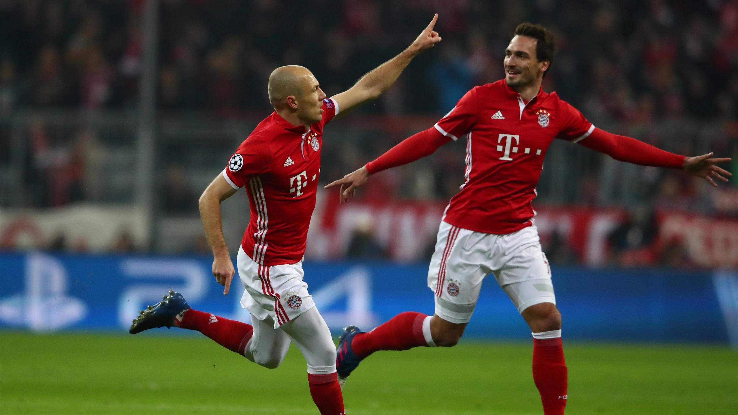 Bayern Munich's Arjen Robben celebrates scoring against Arsenal with Mats Hummels