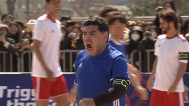 Maradona booked for recreating Hand of God moment