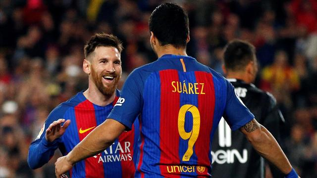 Messi brace keeps Barca in title hunt
