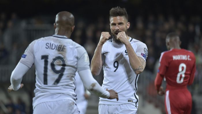 Olivier Giroud celebrates scoring France's first goal against Luxembourg with Djibril Sidibe