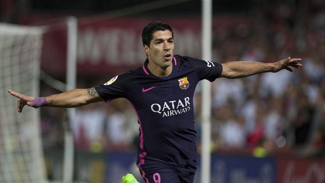 Suarez and Neymar lead Barca to win at Granada