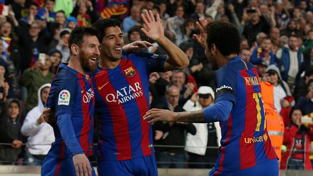 Magical Messi slays Sevilla to boost Barca title hopes