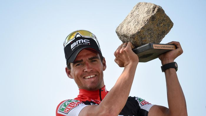 Belgium s Greg Van Avermaet holds his trophy as he celebrates on the podium  after winning the 3c282566e