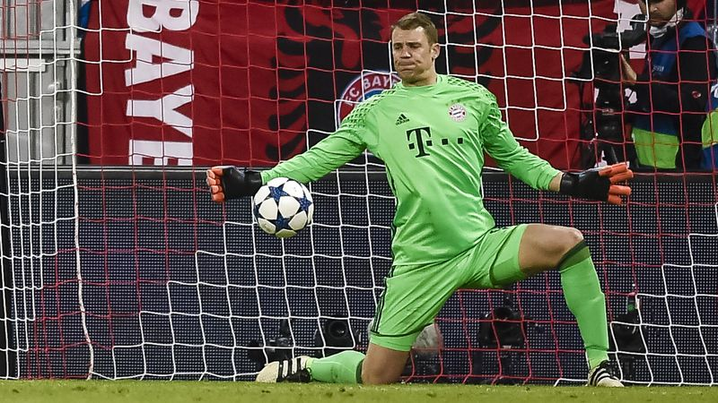 Manuel Neuer makes a save from Cristiano Ronaldo.