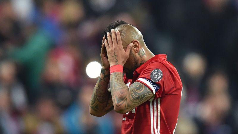 Bayern Munich's Chilian midfielder Arturo Vidal reacts after missing a penalty