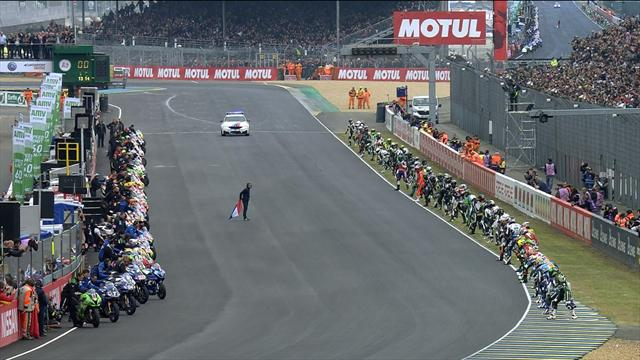Riders sprint across track in Le Mans start