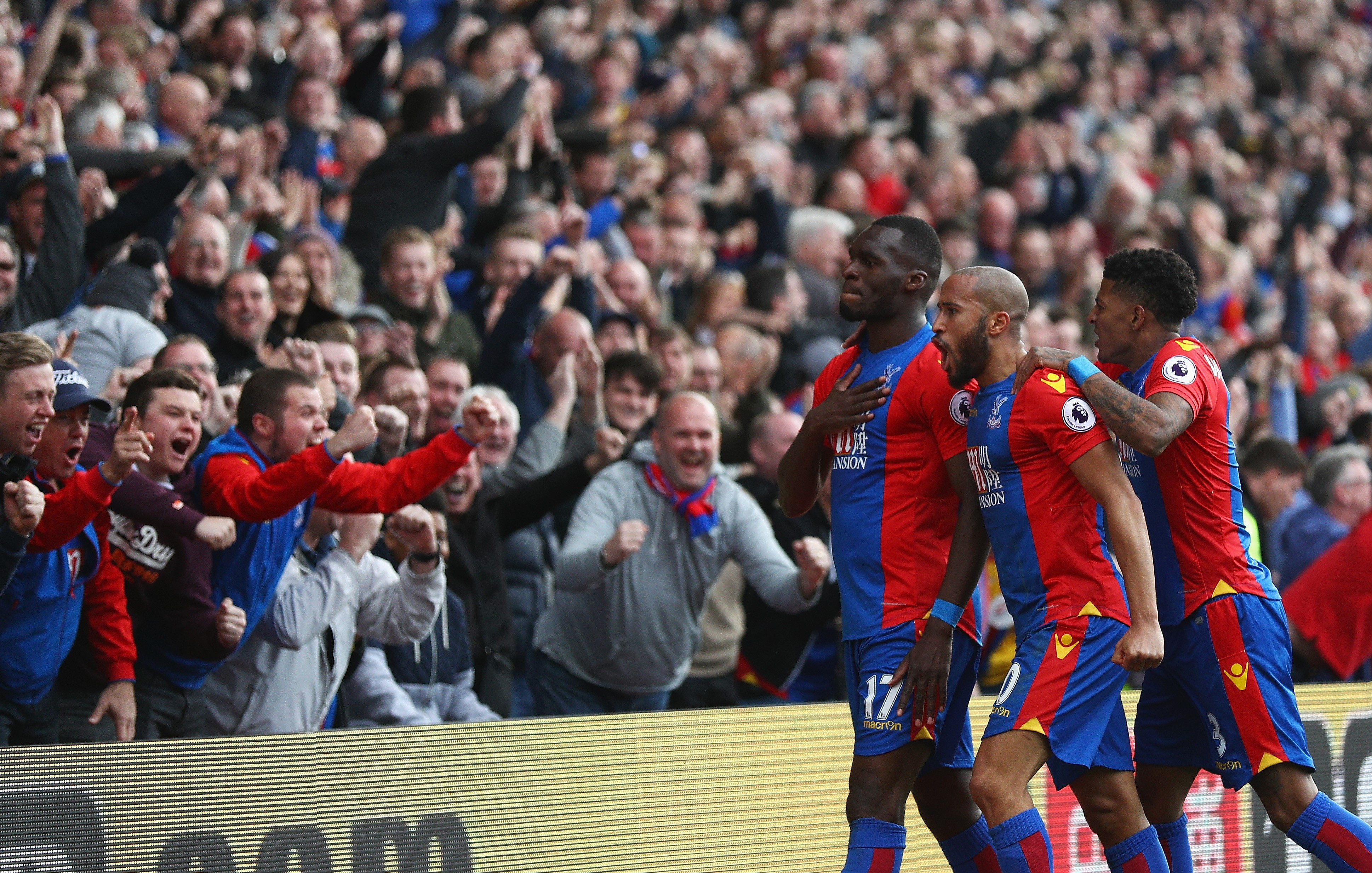 Christian Benteke celebrates equalising for Crystal Palace against Leicester City