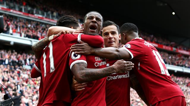Liverpool overcome nerves to seal Champions League place