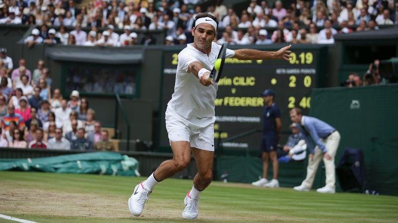 Roger Federer hits a backhand during the Wimbledon final