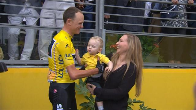 Sealed with a kiss: Chris Froome celebrates with family