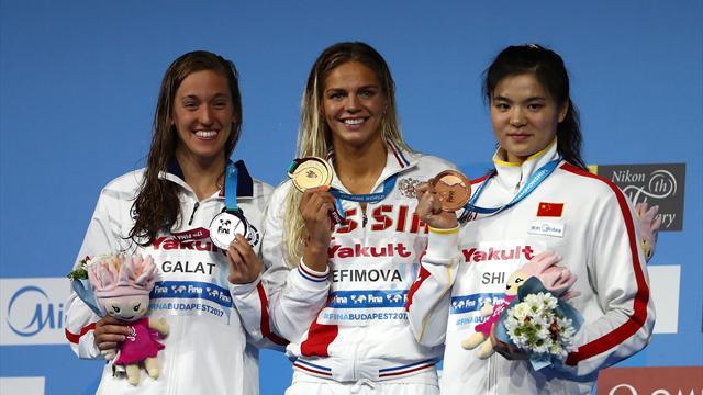 King breaks women's 100m breaststroke record