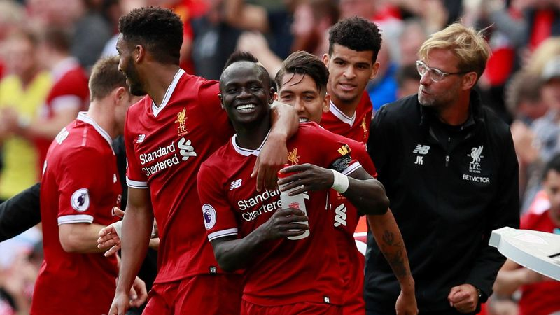 Liverpool's Sadio Mane (C) celebrates scoring their first goal with Liverpool manager Juergen Klopp and team mates.