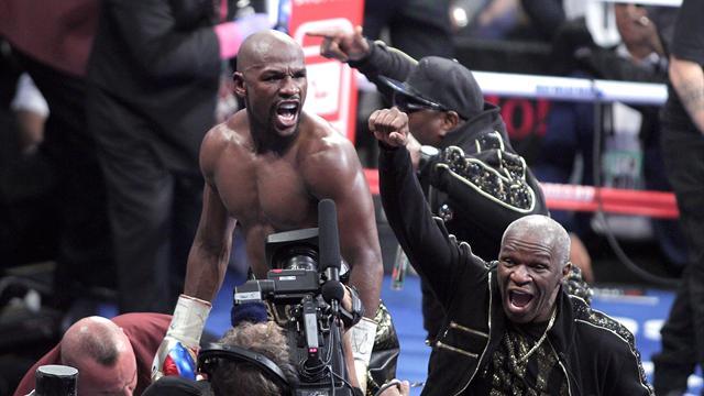 Mayweather rallies to earn TKO win over fading McGregor, confirms retirement