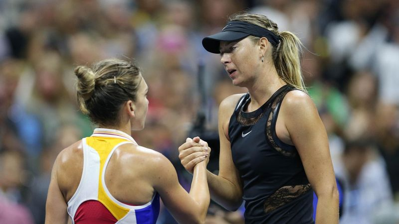 ; Maria Sharapova of Russia (right) shakes hands with Simona Halep (left) after their match on day one of the U.S. Open tennis tournament at USTA Billie Jean King National Tennis Center