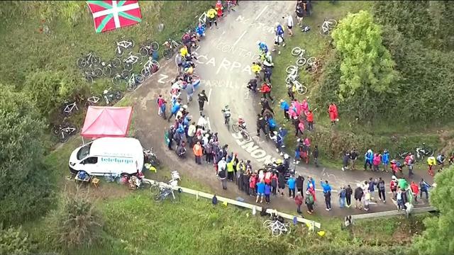 Contador makes contact with fan as he climbs L'Angliru