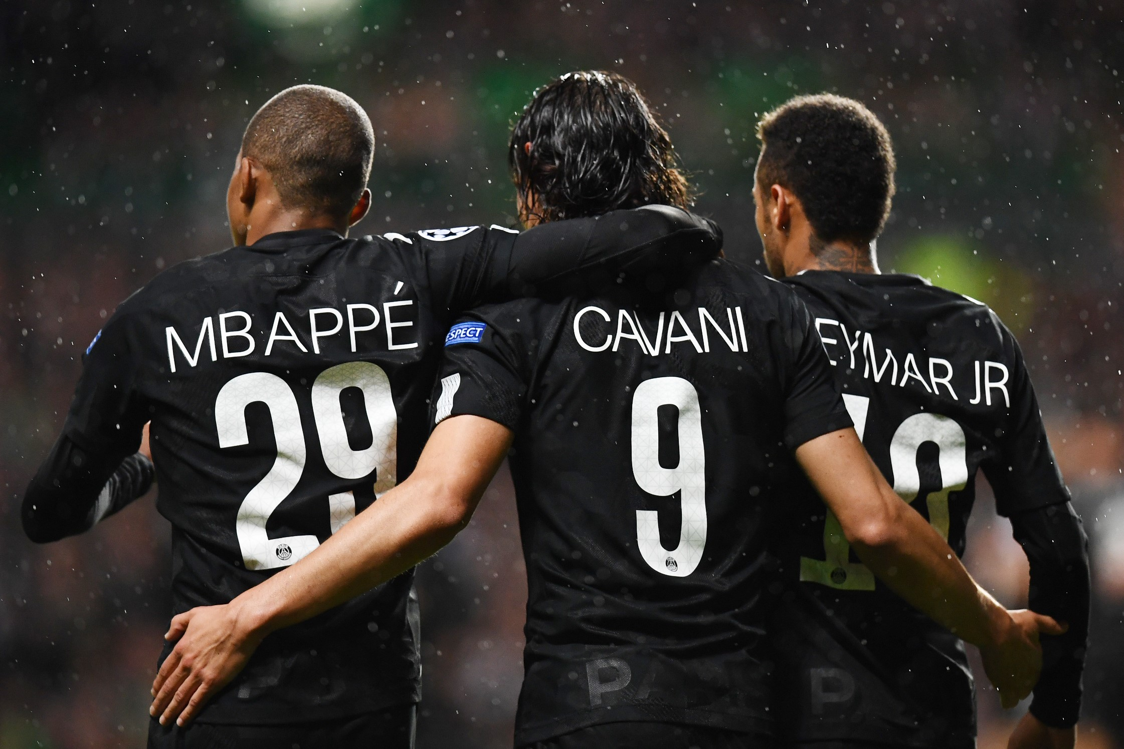 Paris Saint-Germain's Brazilian striker Neymar (R) celebrates with Paris Saint-Germain's French striker Kylian Mbappe (L) and Paris Saint-Germain's Uruguayan striker Edinson Cavani (C) after scoring the opening goal of the UEFA Champions League Group B fo