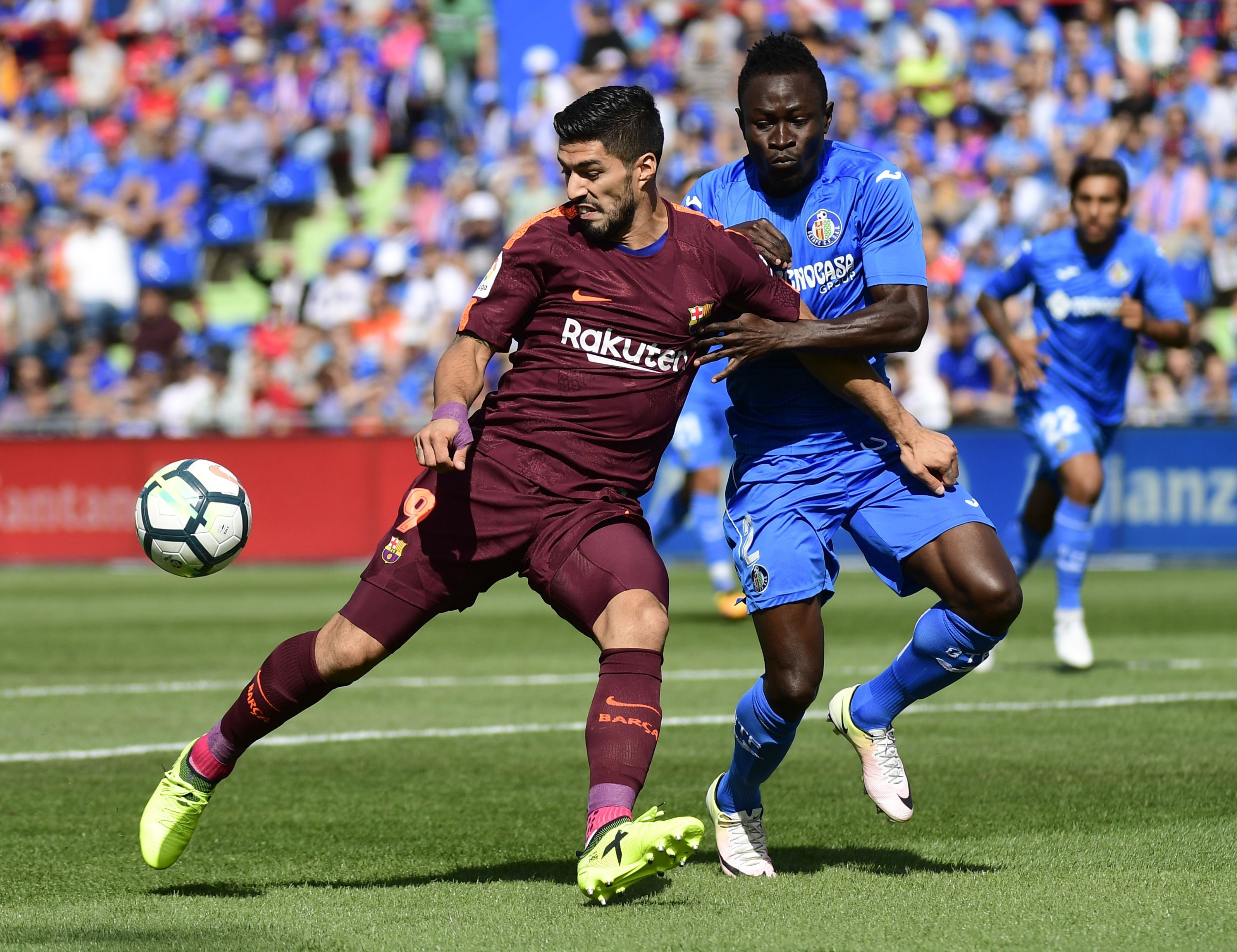 Barcelona's Luis Suarez takes on Dakonam Djene of Getafe