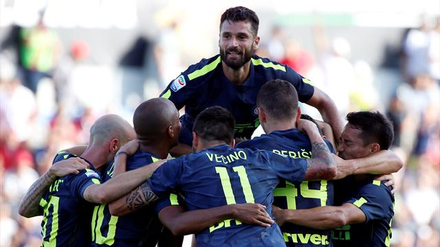 Inter score two late goals to maintain perfect start