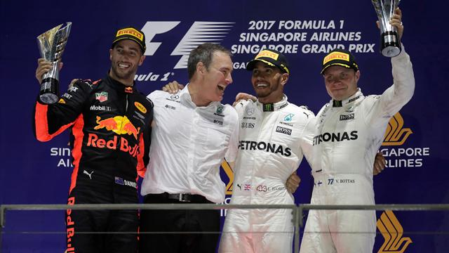 Hamilton claims huge victory in Singapore after dramatic early Vettel crash