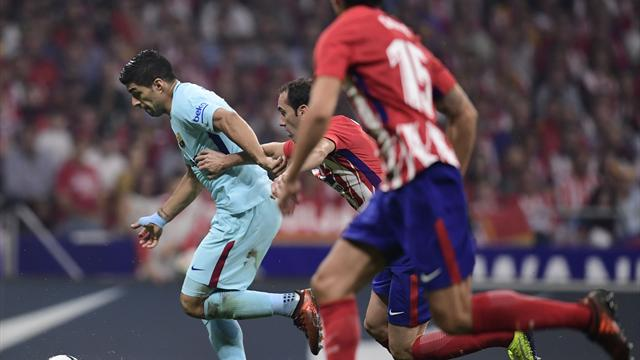 Suarez goal earns Barcelona point at Atletico