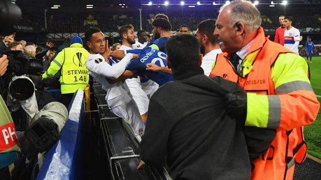Koeman blames referee for pitch brawl as Everton fan with child hits Lyon goalkeeper
