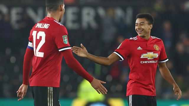 Lingard double sends United into quarter-finals