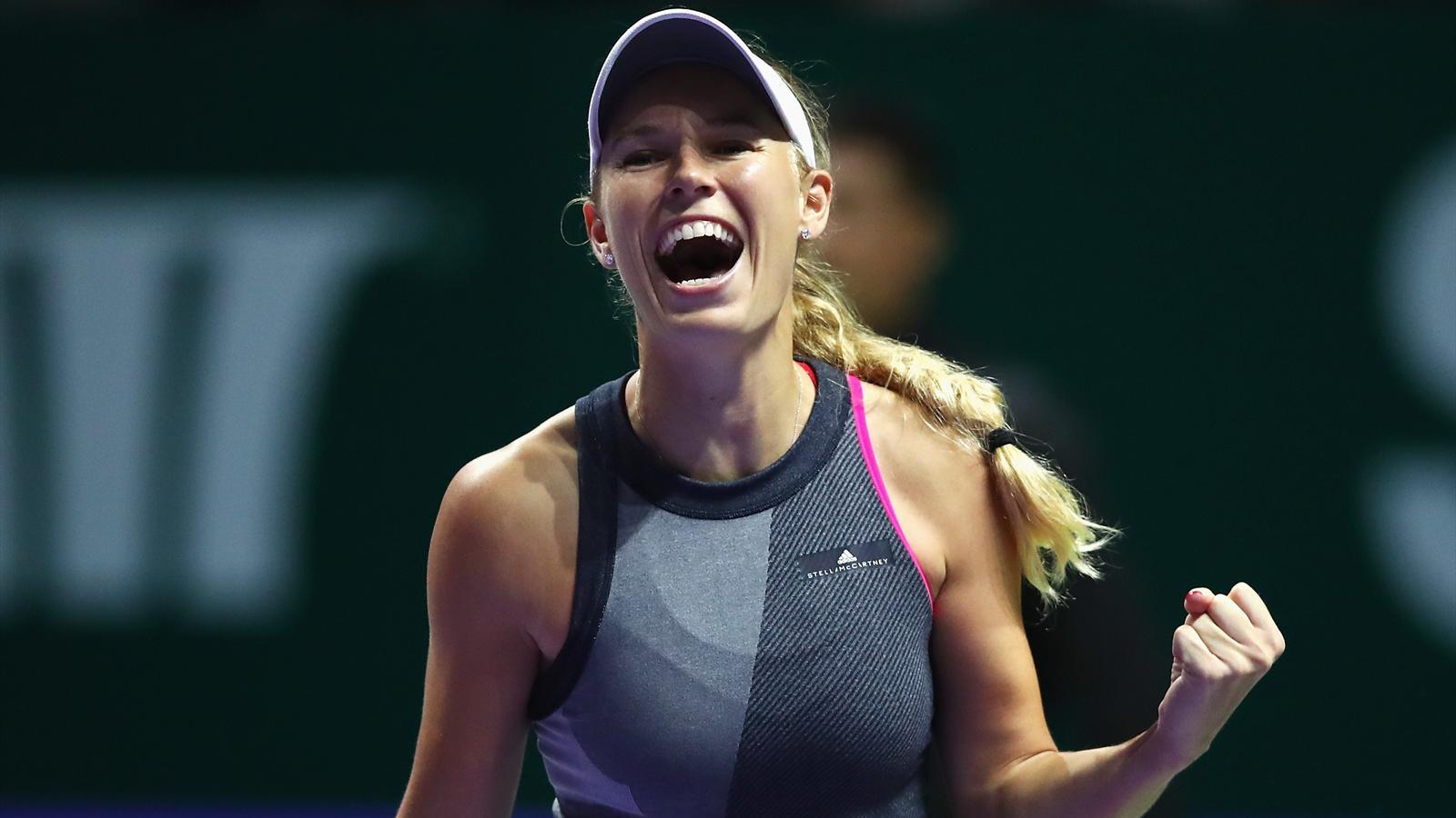 Wozniacki wins epic battle against Venus Williams to claim WTA..