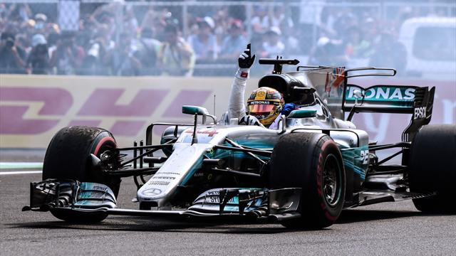 Hamilton avoids taxing times by revelling in fourth world title