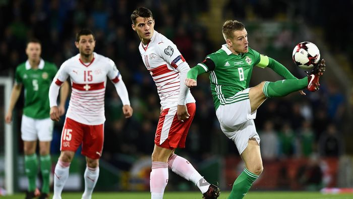 Steven Davis Of Northern Ireland And Granit Xhaka Switzerland In Action During The Fifa 2018