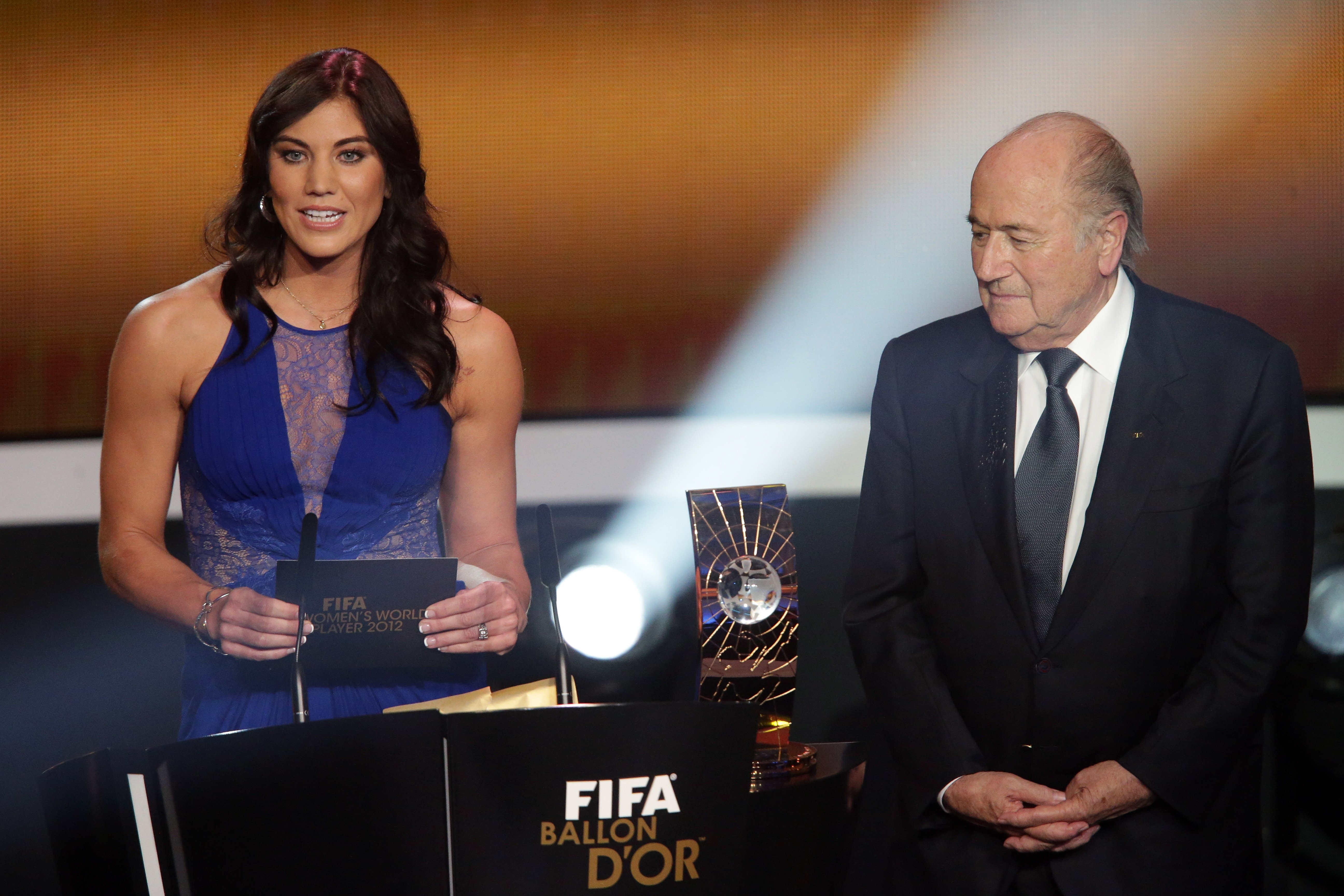 Hope Solo and Joseph Blatter, FIFA president announce Abby Wambach of United States during the FIFA womens player of the year trophy during the FIFA Ballon d'Or Gala 2013 at Congress House on January 07, 2013 in Zurich, Switzerland.