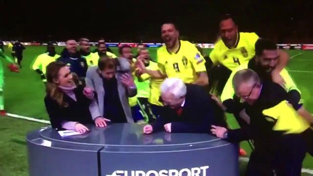 Crazy scenes as Sweden players crash Eurosport pitch-side studio