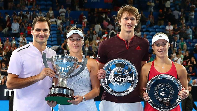 Roger Federer and Belinda Bencic of Switzerland pose with the Hopman Cup trophy together with Alexander Zverev and Angelique Kerber of Germany with the runners up plate after the final on day eight during the 2018 Hopman Cup at Perth Arena