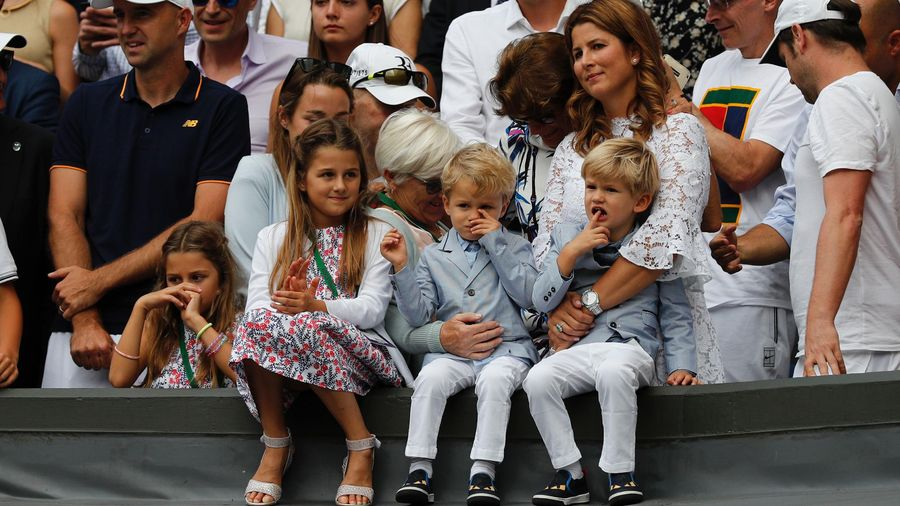 Mirka Federer, wife of Switzerland's Roger Federer, stands with her children Charlene Riva, Myla Rose, Lenny and Leo