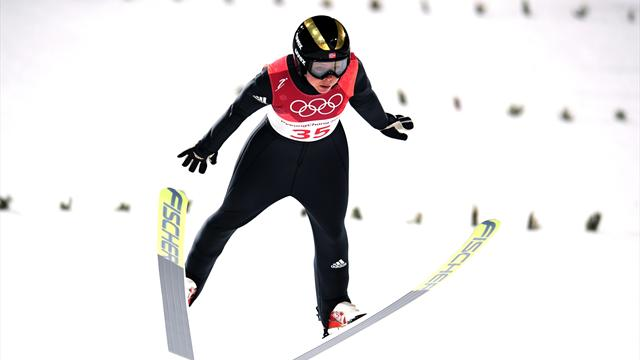 Lundby flies through blizzard to take gold