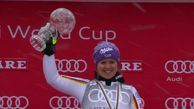 Rebensburg embraced by Worley and Shiffrin on Giant Slalom podium