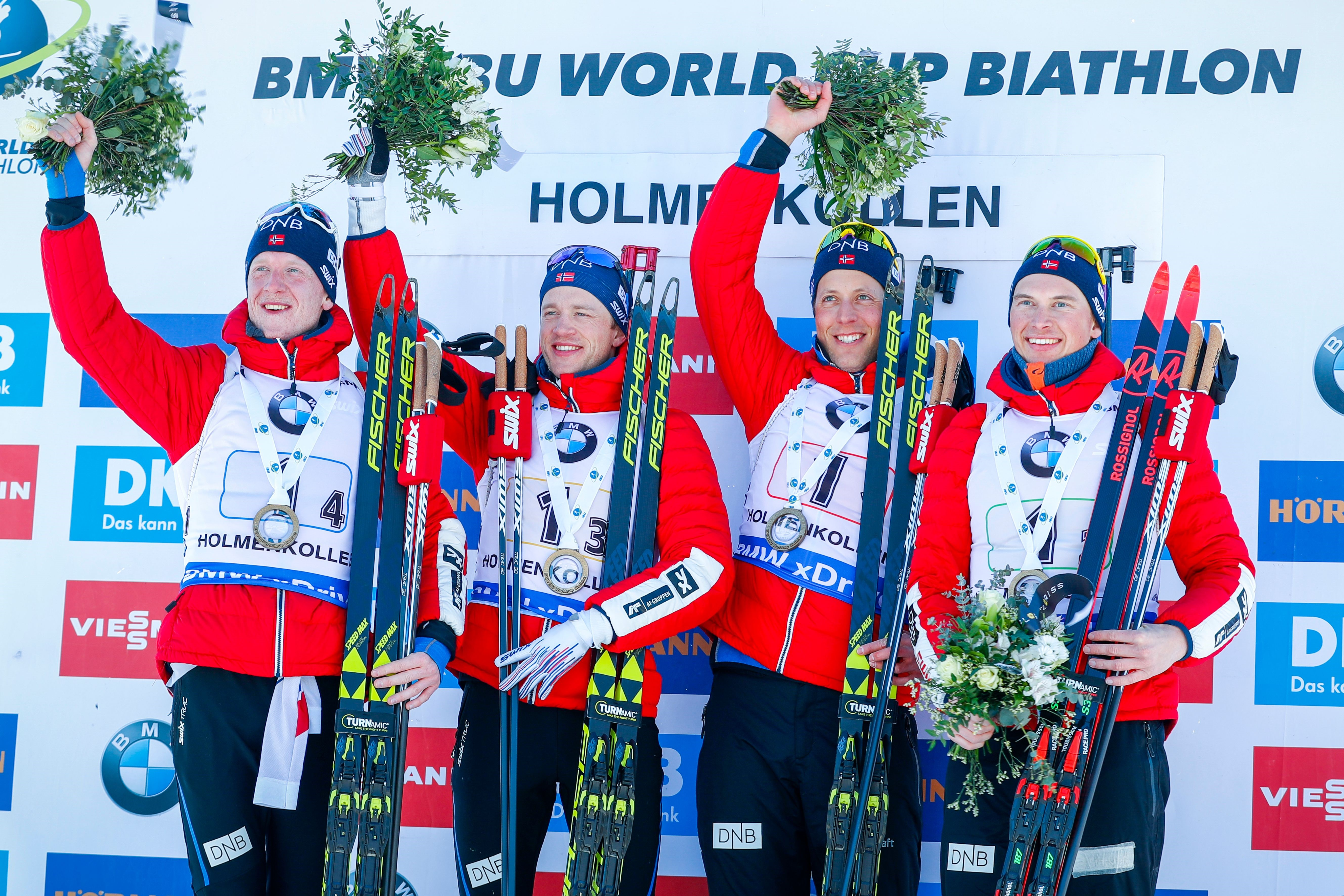 (L-R) Norway's Johannes Thingnes Boe, Tarjei Boe, Lars Helge Birkeland and Henrik L'abee-Lund pose on the podium after winning the IBU Biathlon World Cup Men's 4x7,5 km Relay event in Holmenkollen, Oslo, on March 18. 2018.