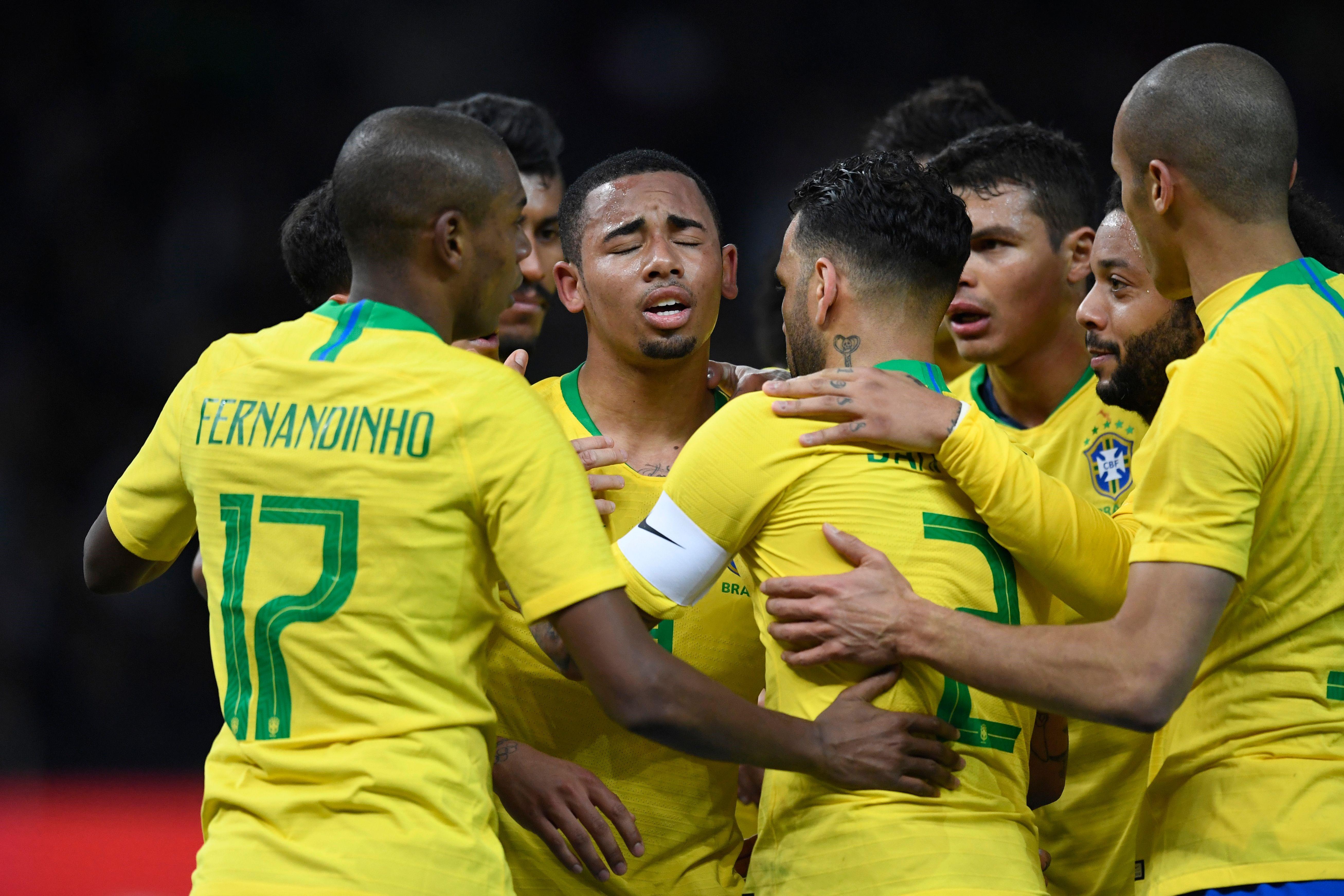 Brazil's team celebrates the goal scored by forward Gabriel Jesus (C)