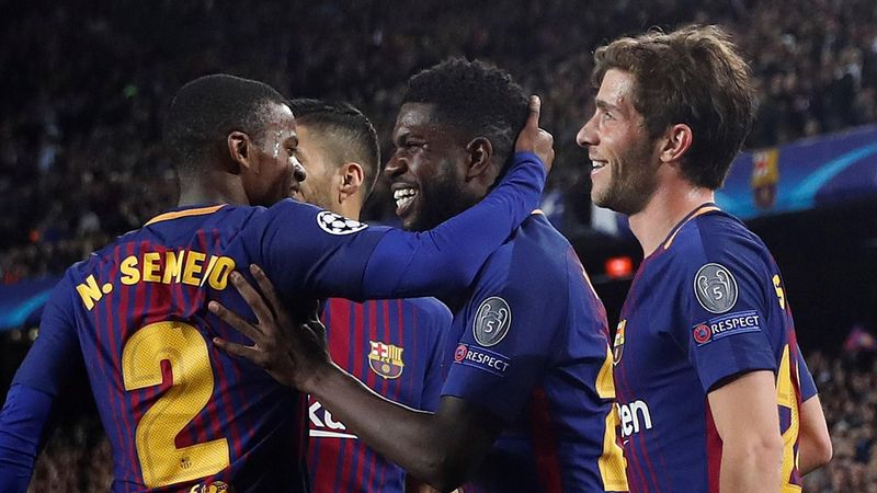 Barcelona's Samuel Umtiti celebrates their second goal with Nelson Semedo and team mates