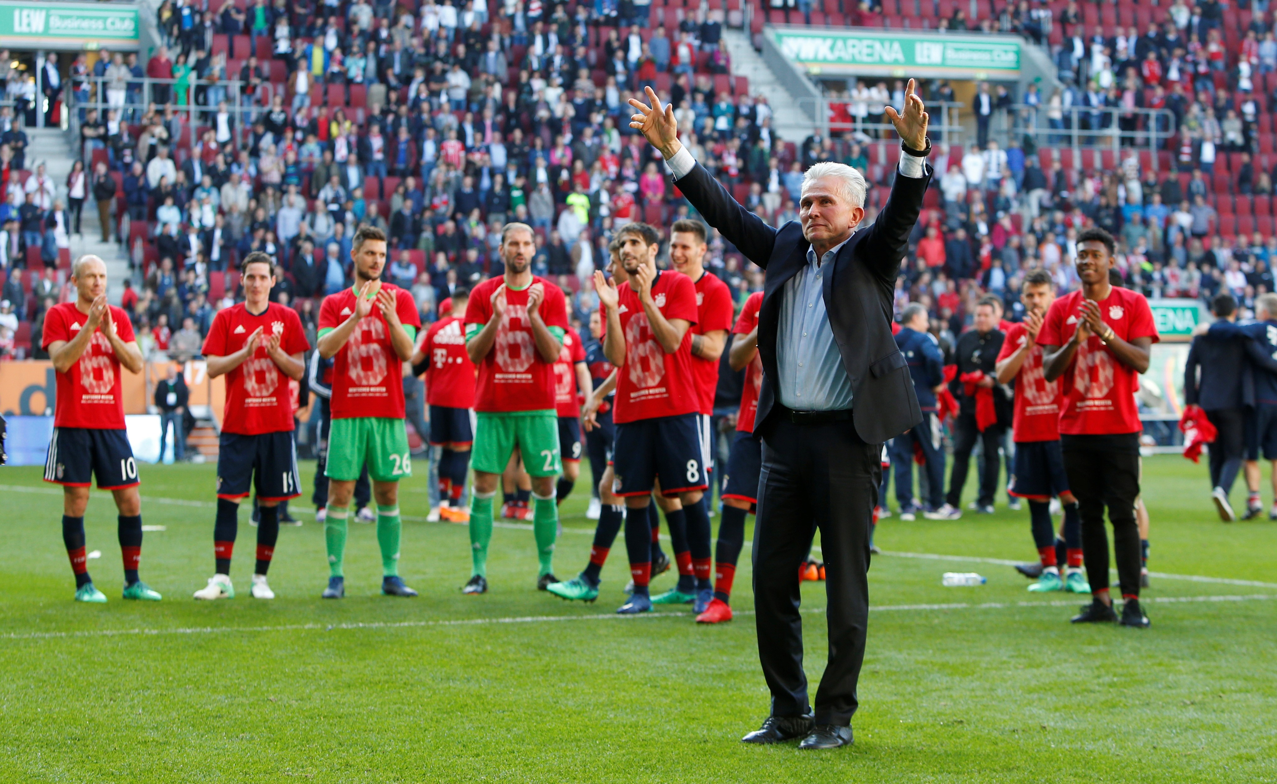 Bayern Munich coach Jupp Heynckes celebrates winning the league in front of the fans at the end of the match.