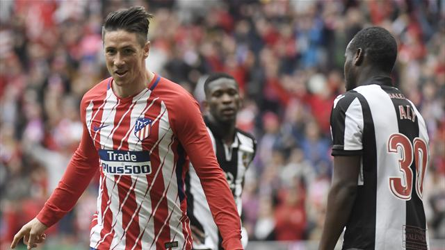 Atletico ease to win over Levante as Torres reaches milestone