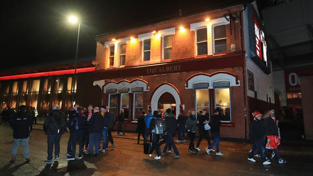 Two men remanded in custody over Liverpool fan attack
