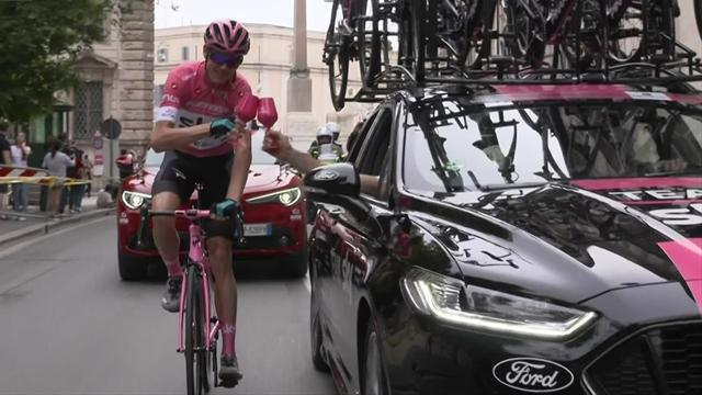 Froome rides pink bike, is handed glass of Prosecco